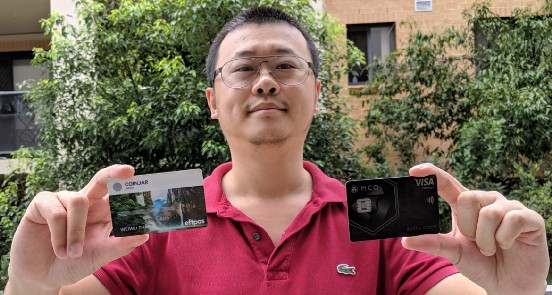 Weiwu Zhang with MCO card